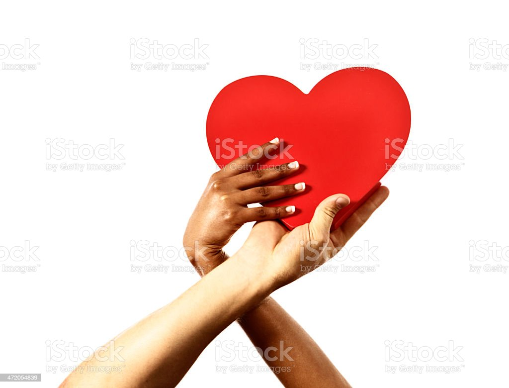 Two hands trying to take possession of red heart: Rivalry! stock photo