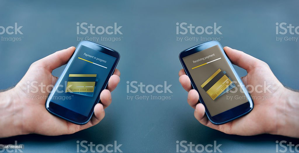 Two hands using smartphones to make a payment stock photo