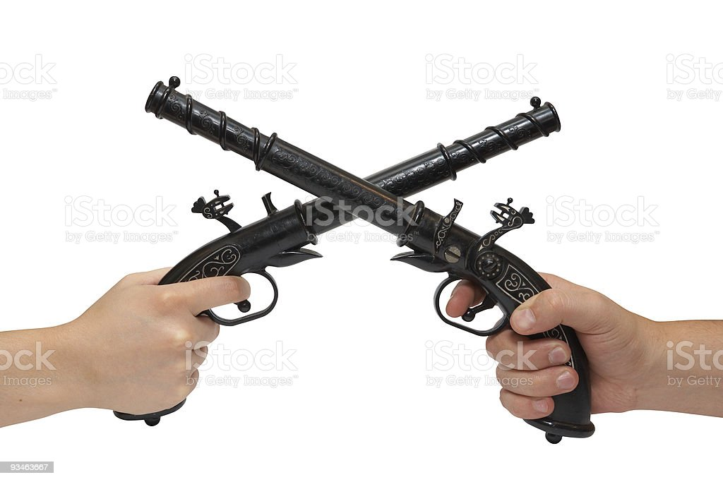 Two hands with an old pistols royalty-free stock photo