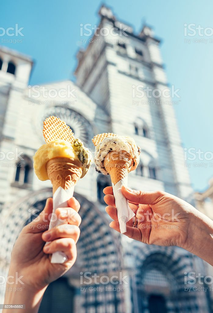 Two hands with ice cream on the San Lorenco Cathedral stock photo