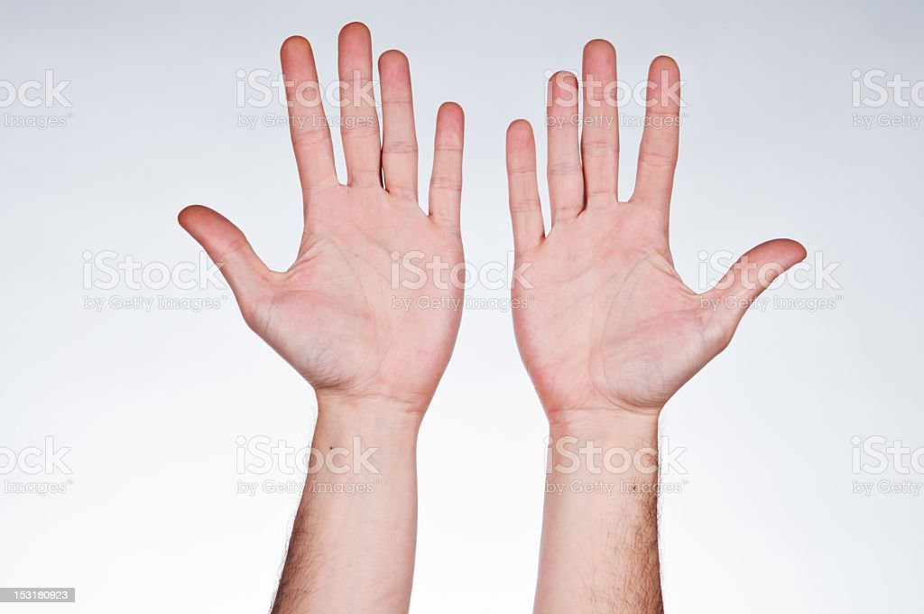 Two hands with palms facing up stock photo