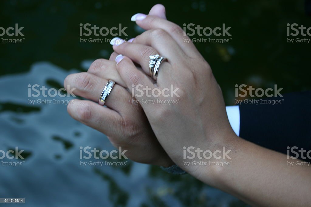 Two hands with wedding rings stock photo
