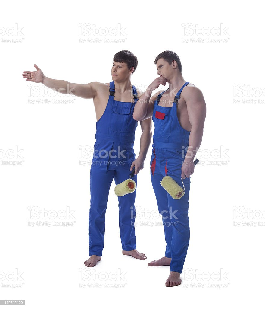 Two handsome painters in blue overalls royalty-free stock photo
