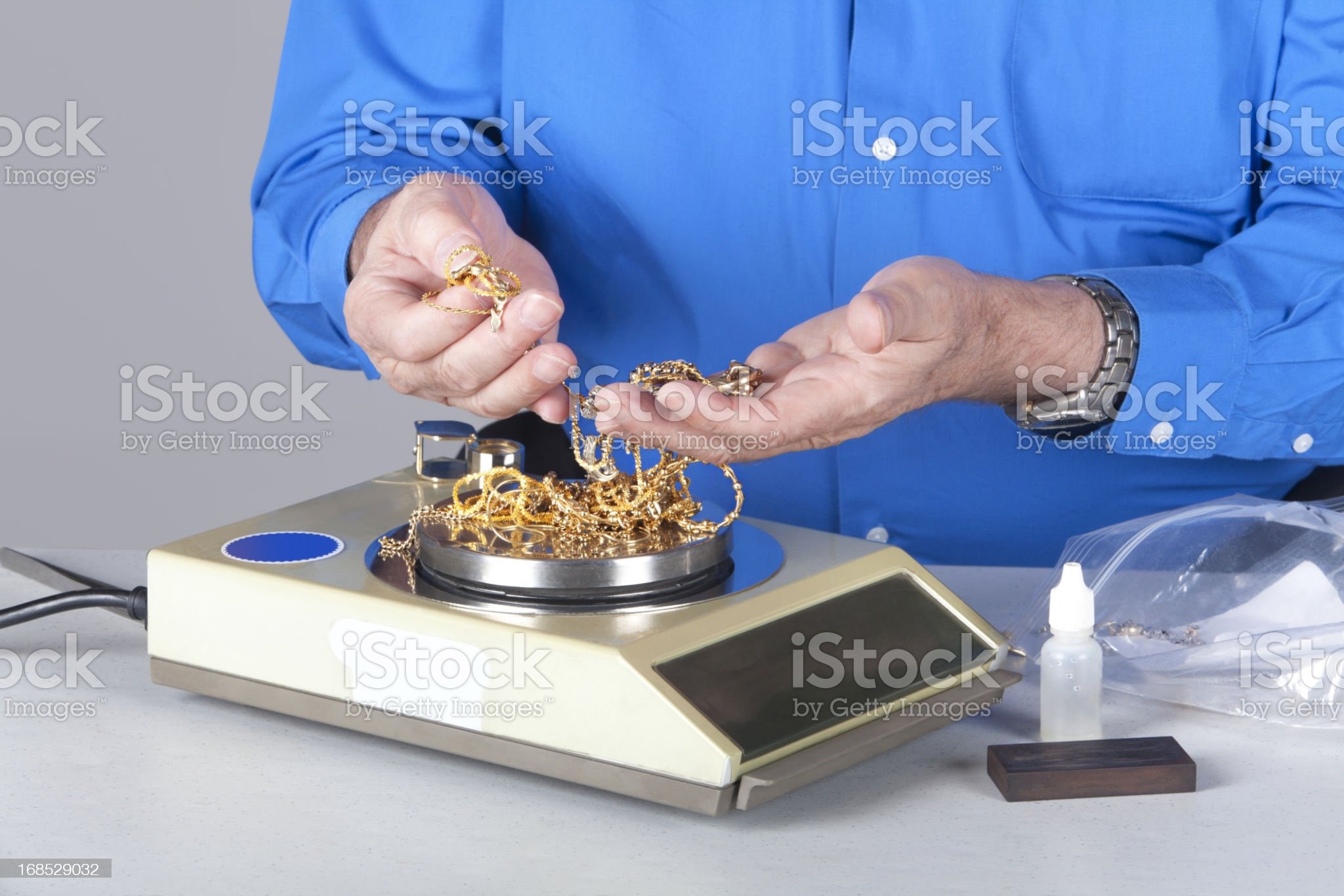 Two handy holding and weighing scrap gold royalty-free stock photo
