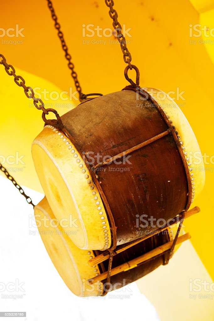 Two hanging buddhist drums stock photo