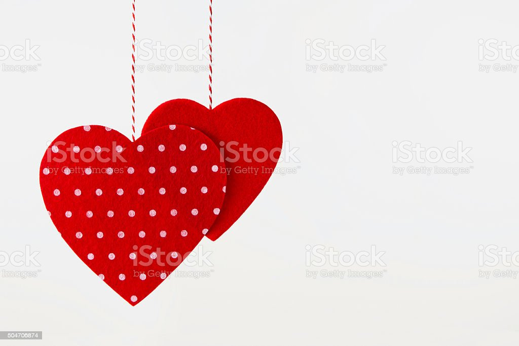 Two Hanging Red Hearts stock photo