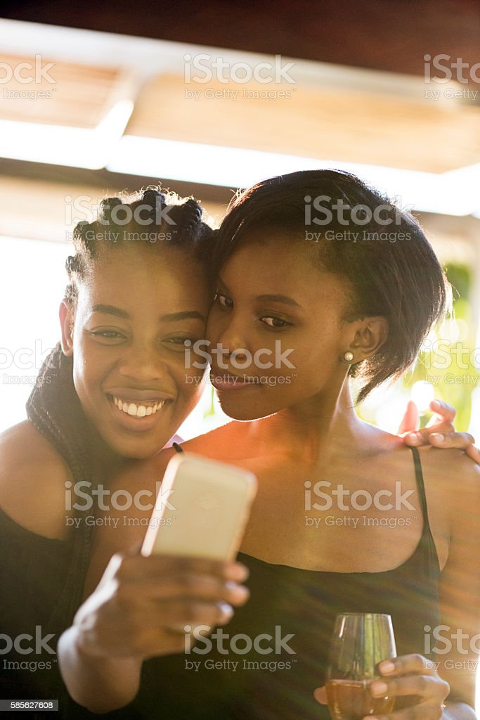 Two Happy African Women Posing For a Selfie stock photo