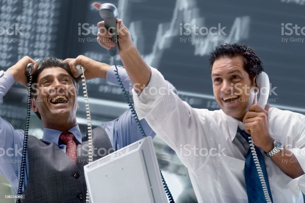 Two Happy Brokers at Stock Exchange royalty-free stock photo