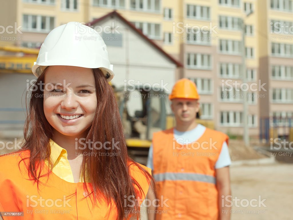 two happy builders in hardhat royalty-free stock photo