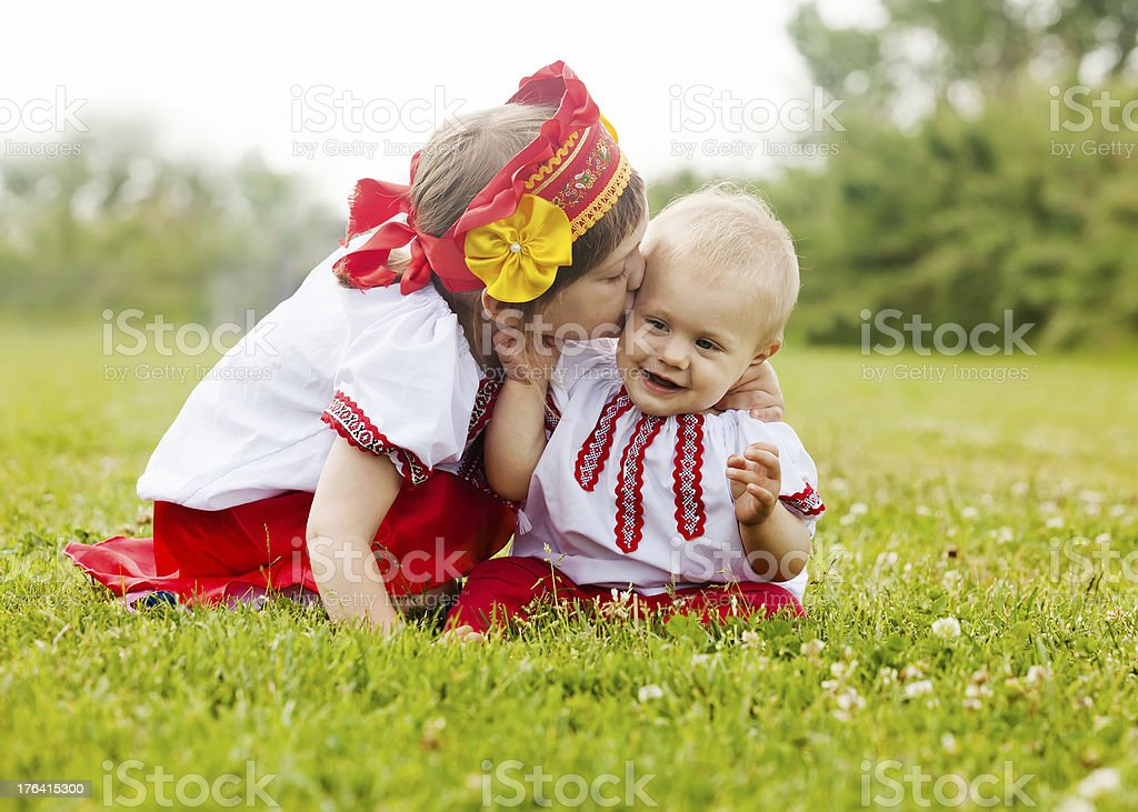 Two happy children in  folk clothes royalty-free stock photo