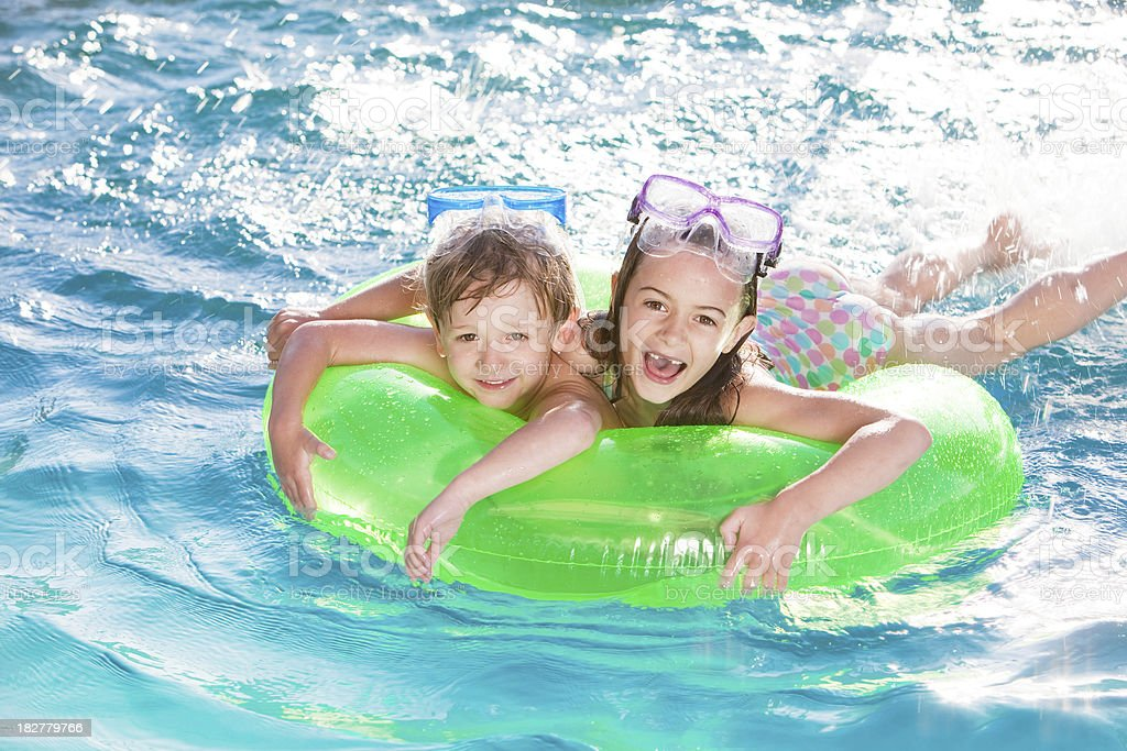 Two Happy Children Swimming in the Pool royalty-free stock photo