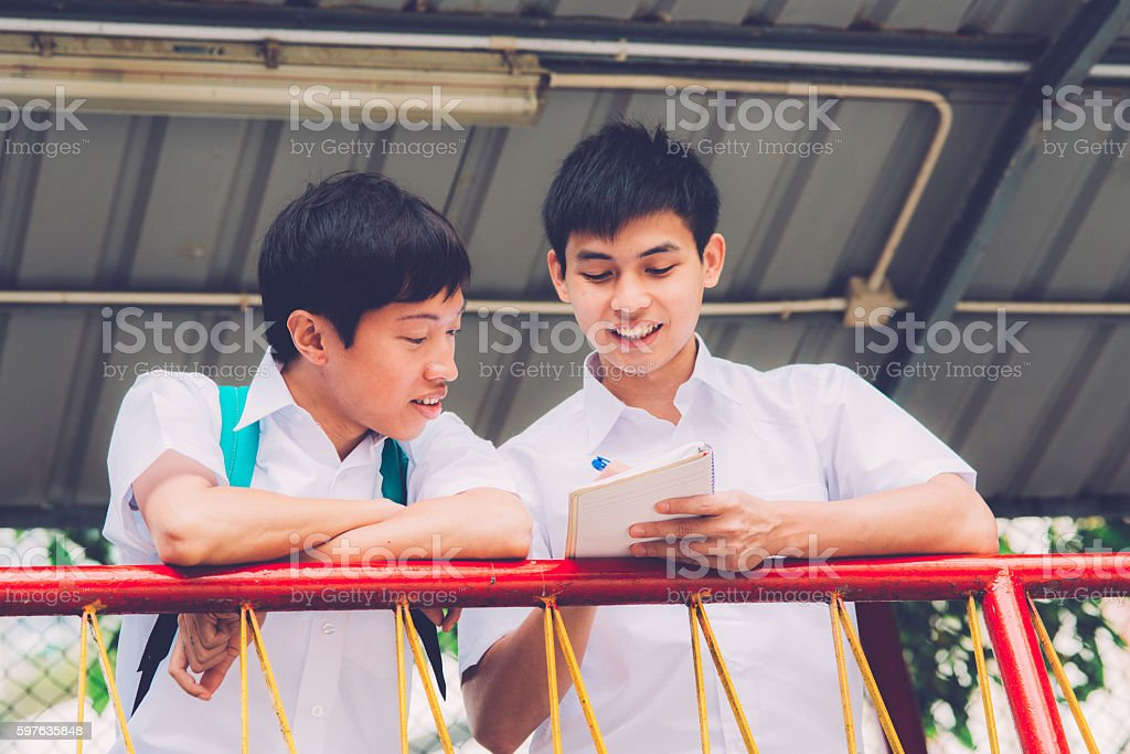 Two Happy Chinese Students Studying in Hong Kong, China, Asia stock photo