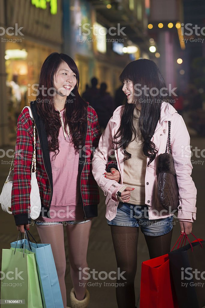 two happy chinese women with shopping bags royalty-free stock photo