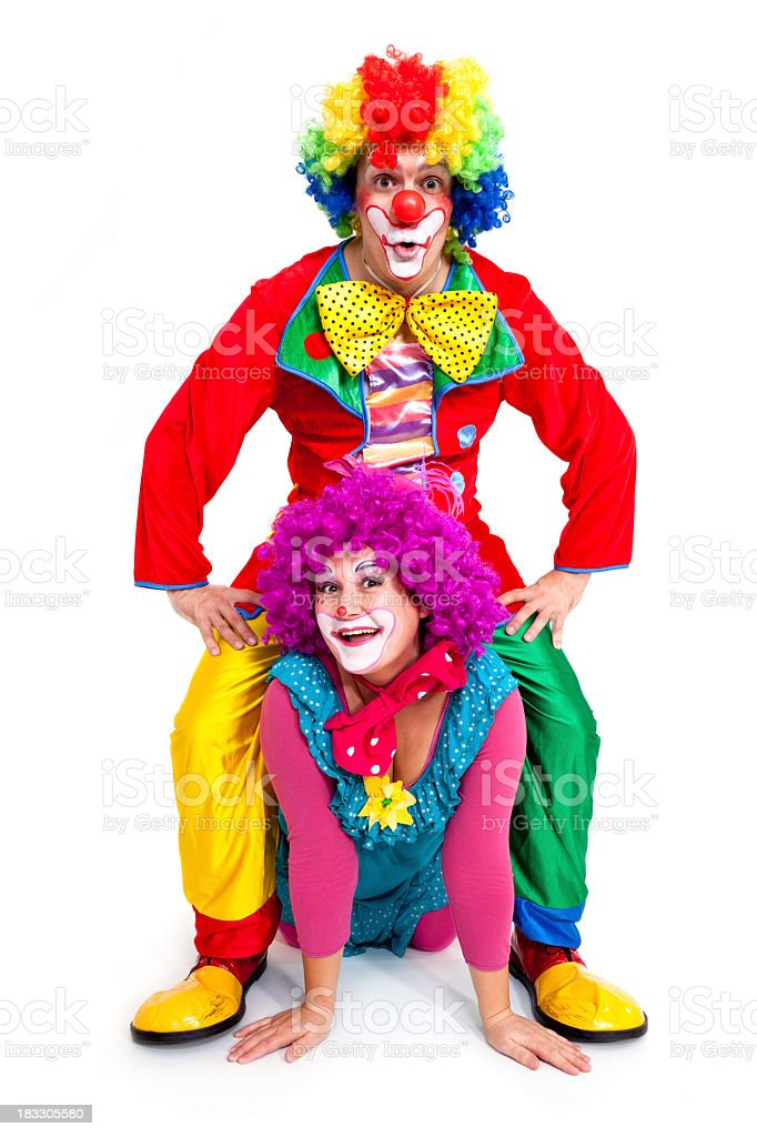 Two happy clowns on white background stock photo
