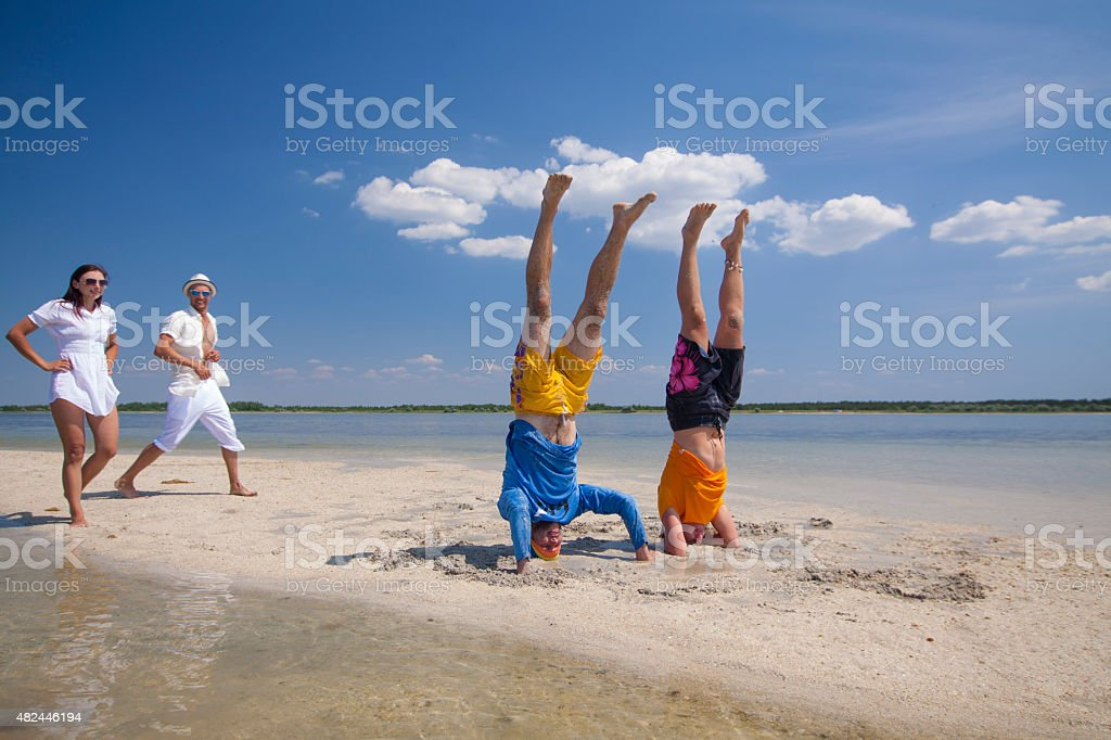 Two happy couples on the beach royalty-free stock photo
