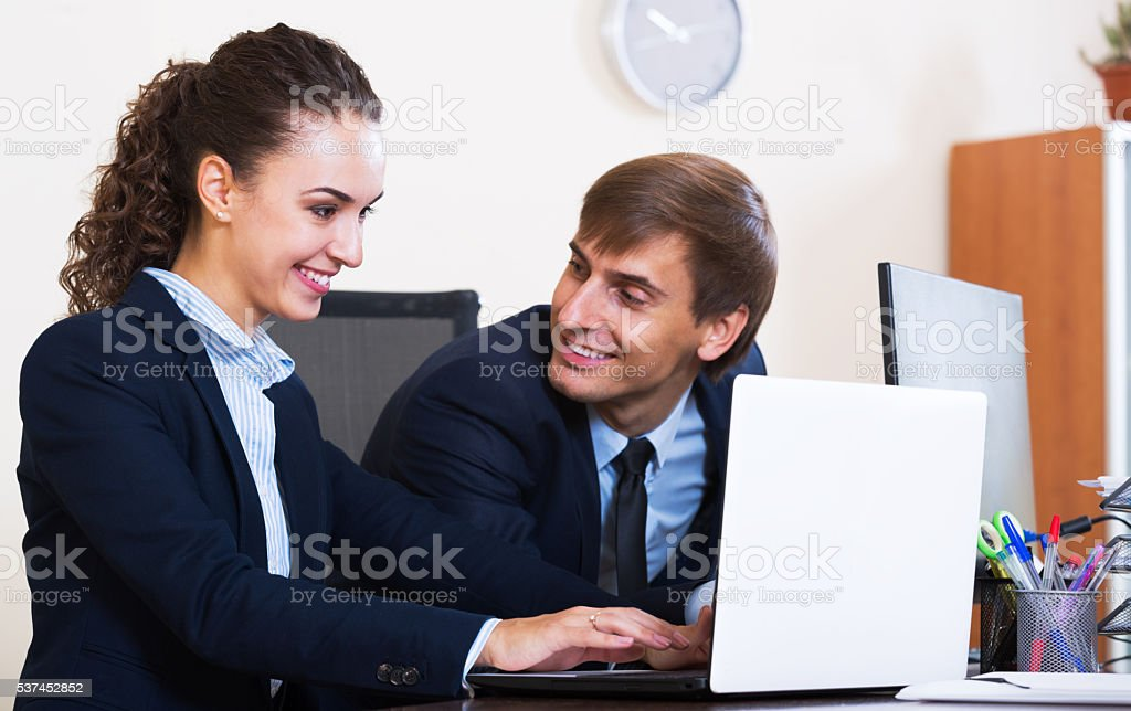 two happy employees in office stock photo