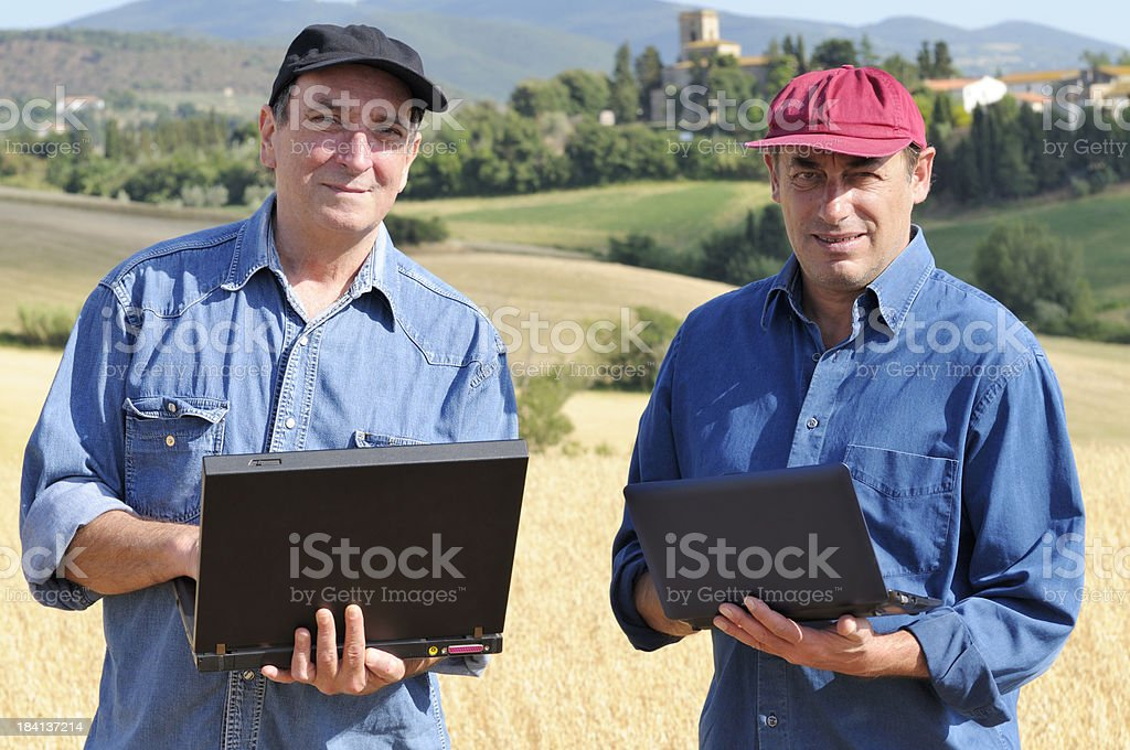 Two Happy Farmers Planning PC royalty-free stock photo