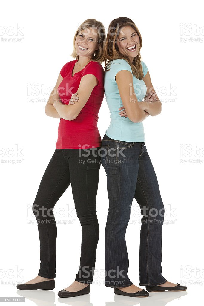 Two happy female friends standing together royalty-free stock photo
