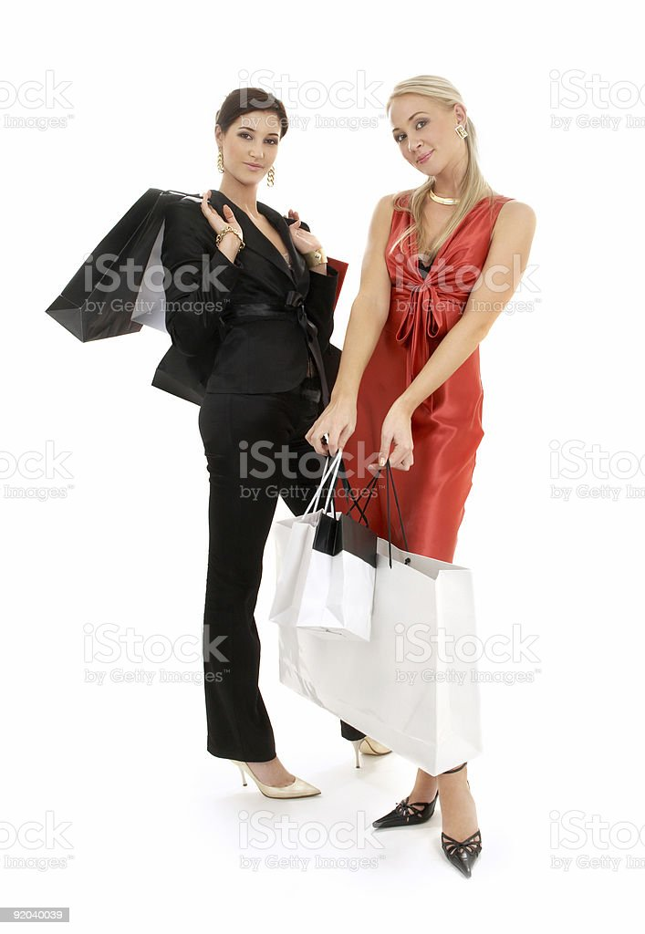 two happy girls with shopping bags royalty-free stock photo