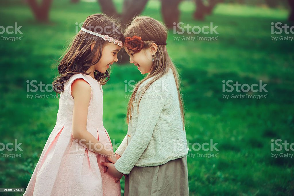 two happy kid girl playing together in summer, outdoor activities stock photo