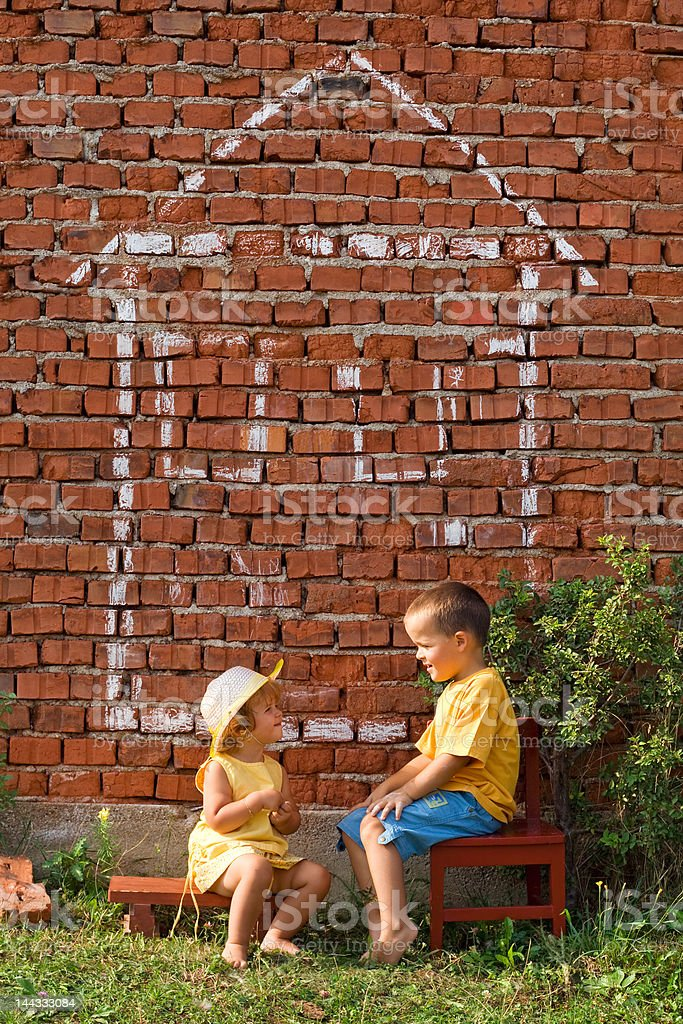 Two happy kids talking royalty-free stock photo