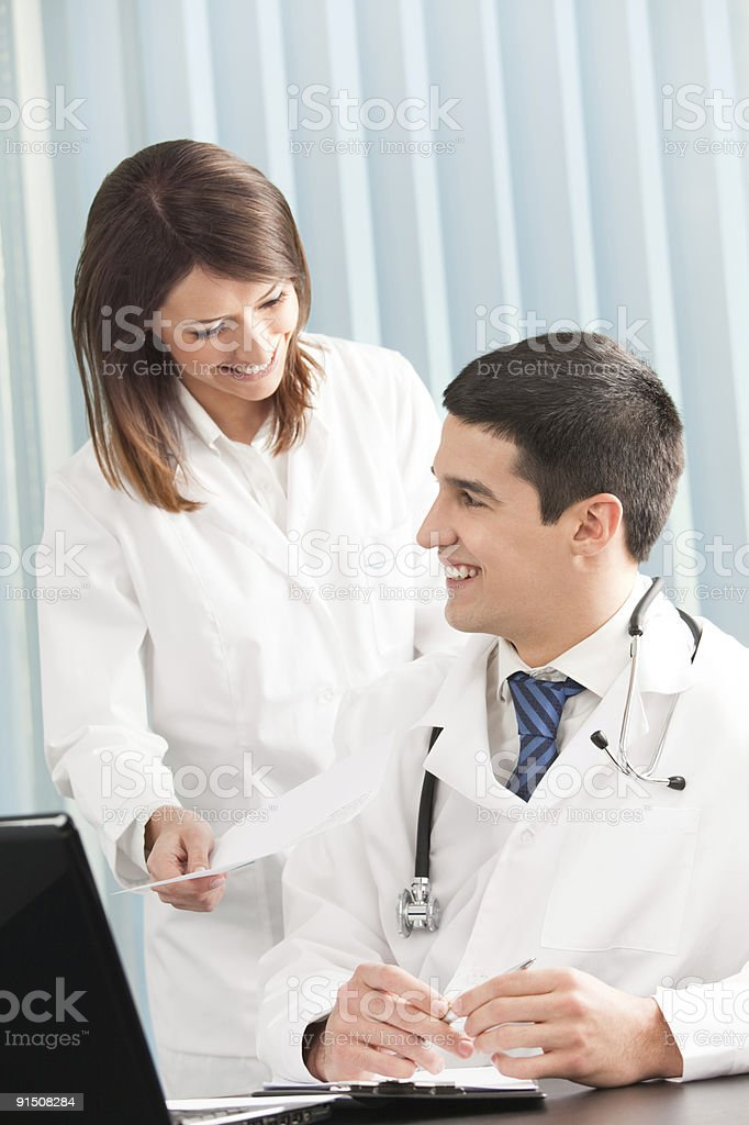 Two happy medical people working together at office royalty-free stock photo
