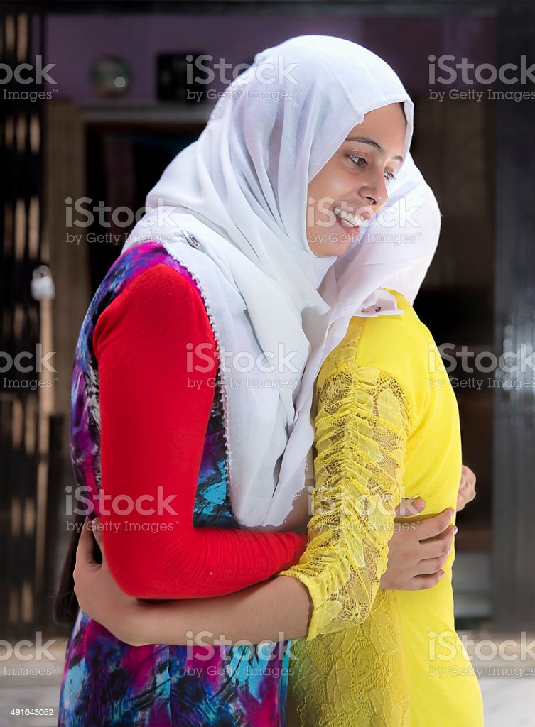 Two Happy Muslim women embracing each other on Eid. stock photo