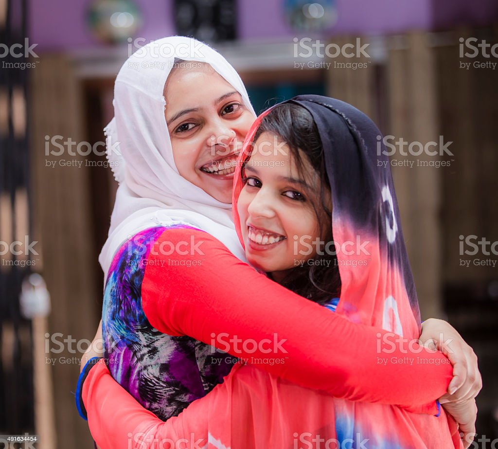 Two Happy Muslim women with traditional veil stock photo