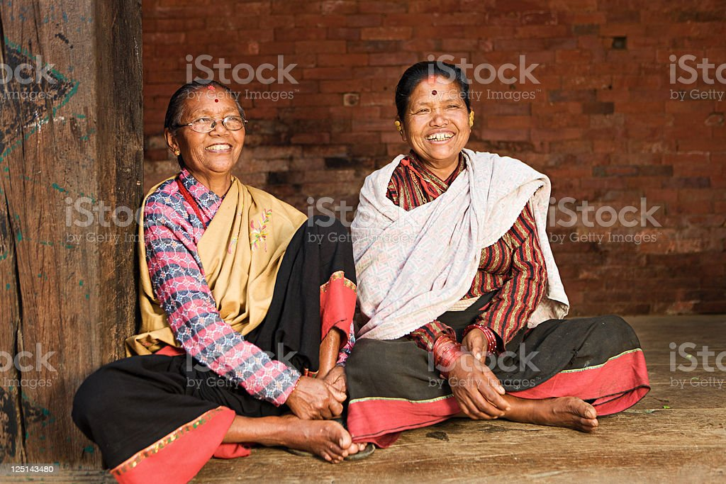 Two happy Nepali women in Bhaktapur, Durbar Square royalty-free stock photo