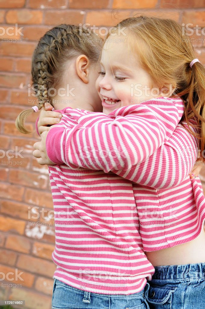 Two Happy Sisters Hugging Each Other royalty-free stock photo