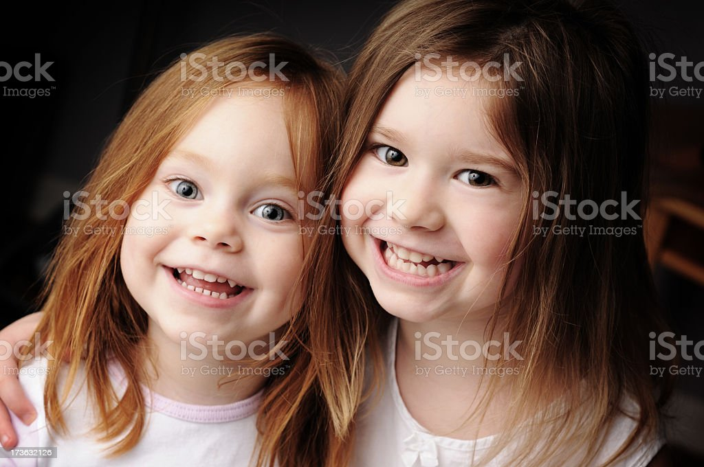 Two Happy Sisters Smiling and Hugging royalty-free stock photo