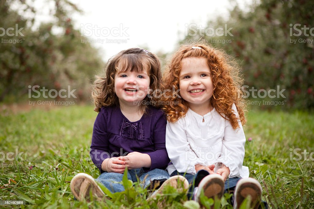 Two Happy Sisters Smiling and Laughing Together Outside royalty-free stock photo