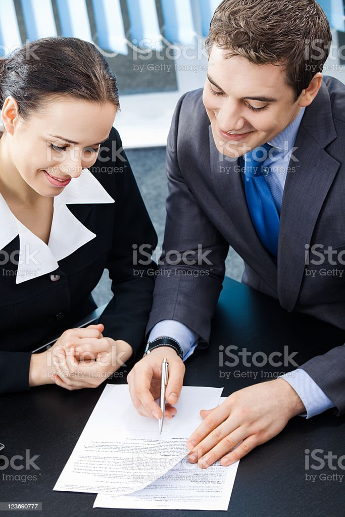 Two happy smiling young businesspeople working royalty-free stock photo