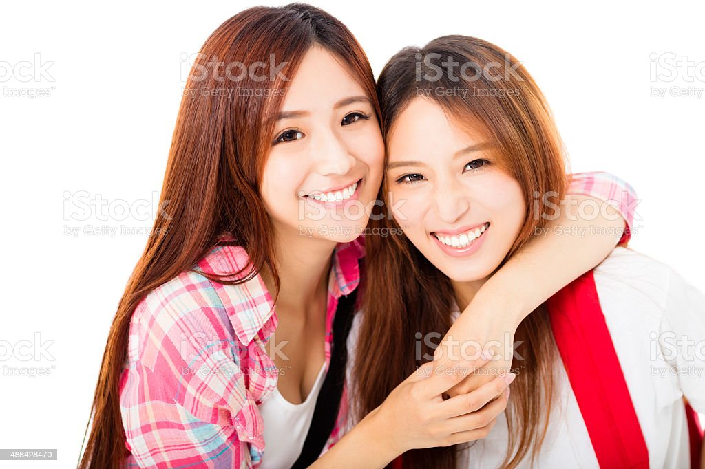 Two  happy teenage students girls isolated on white stock photo