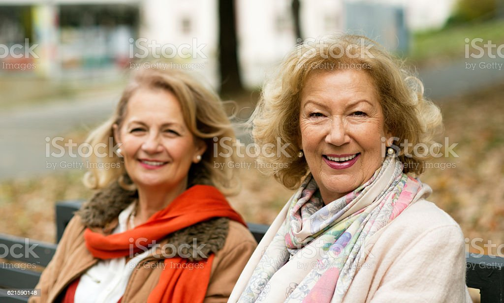 Two happy woman looking at camera. stock photo
