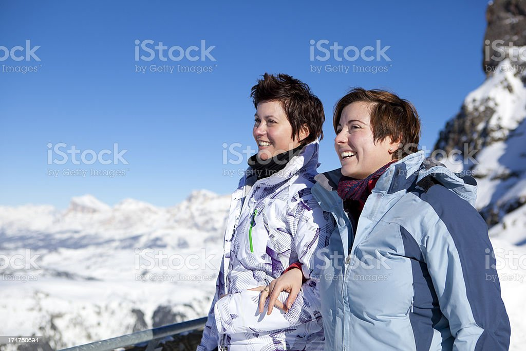 Two happy women in winter landscape royalty-free stock photo