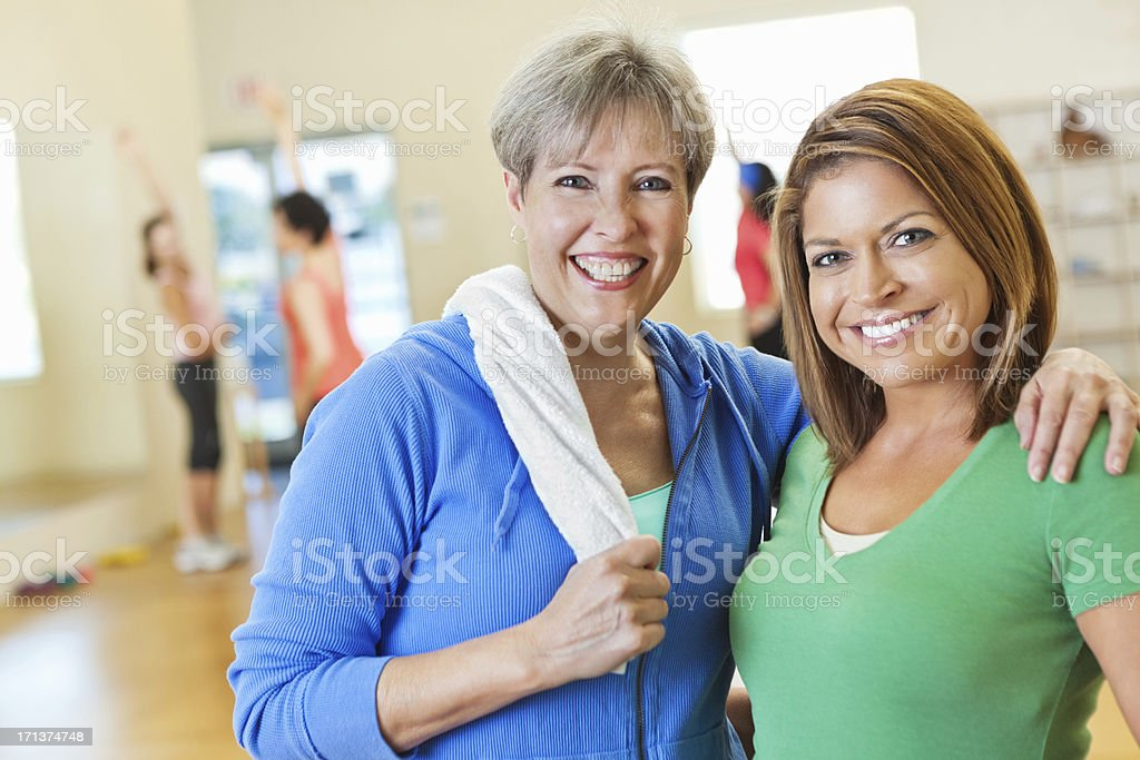 Two happy women posing in exercise fitness class royalty-free stock photo