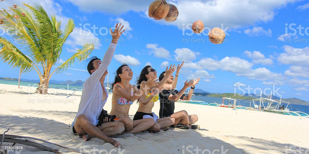 Two happy young couples having fun on tropical white beach royalty-free stock photo