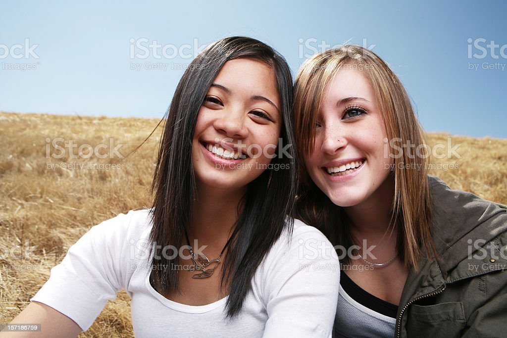 Two Happy Young Friends in a Field royalty-free stock photo