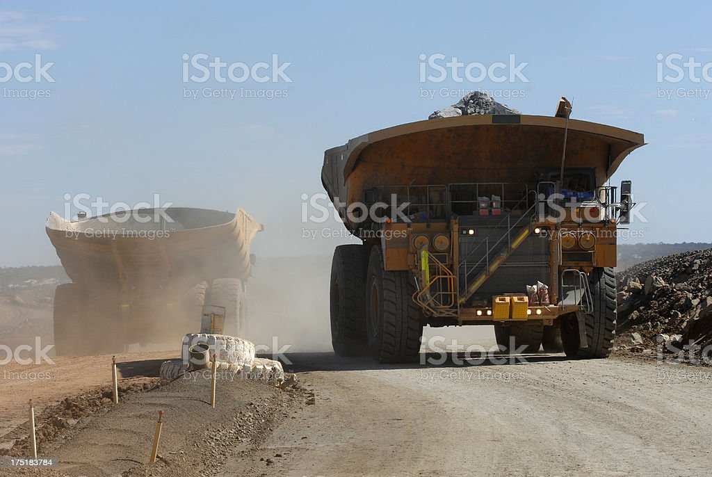 Two haul trucks driving on a minesite. royalty-free stock photo