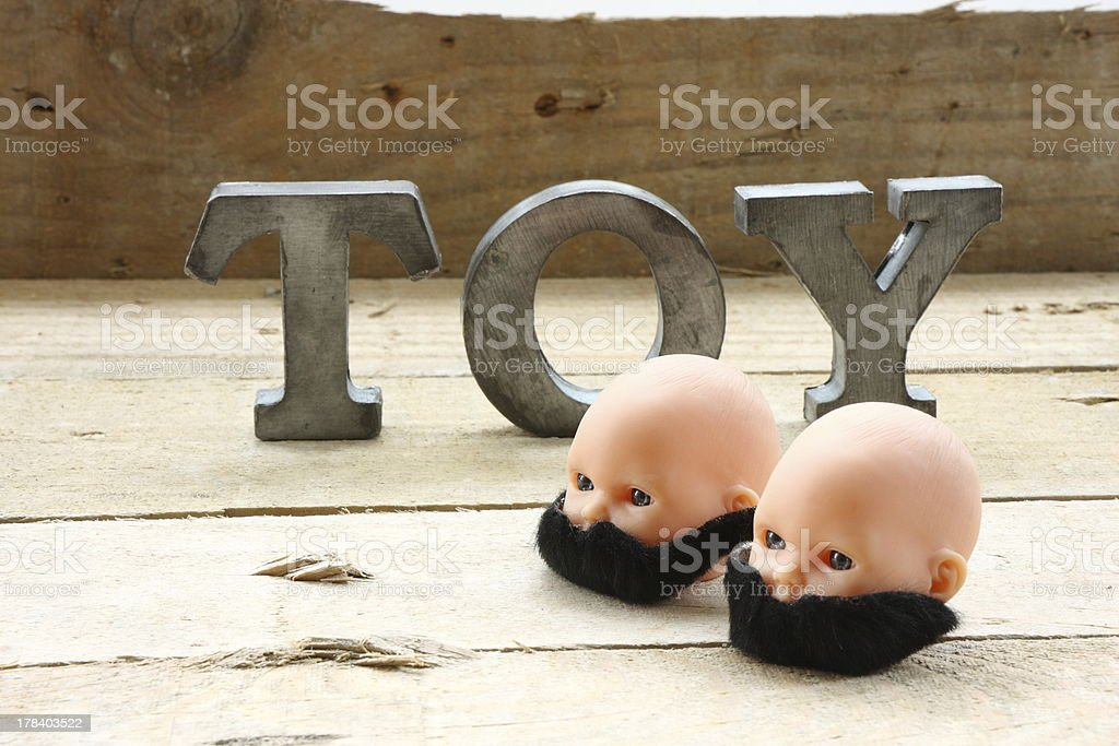 Two heads with mustaches royalty-free stock photo