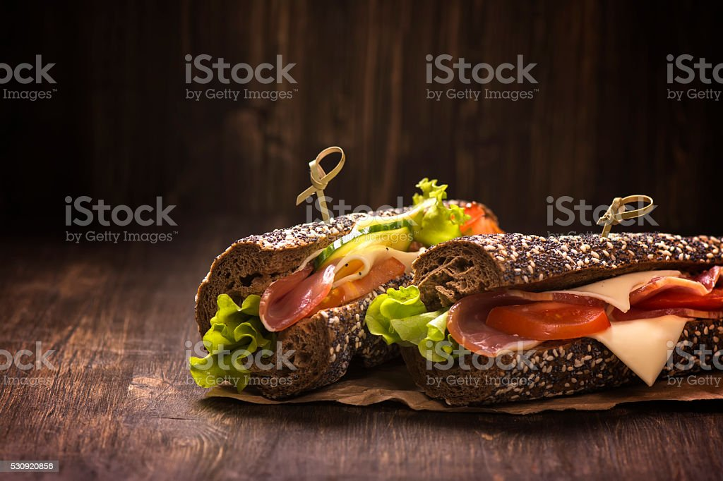 Two healthy sandwiches with ham, cheese and vegetables stock photo