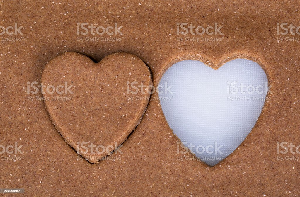 two heart shape carved on pastry background stock photo
