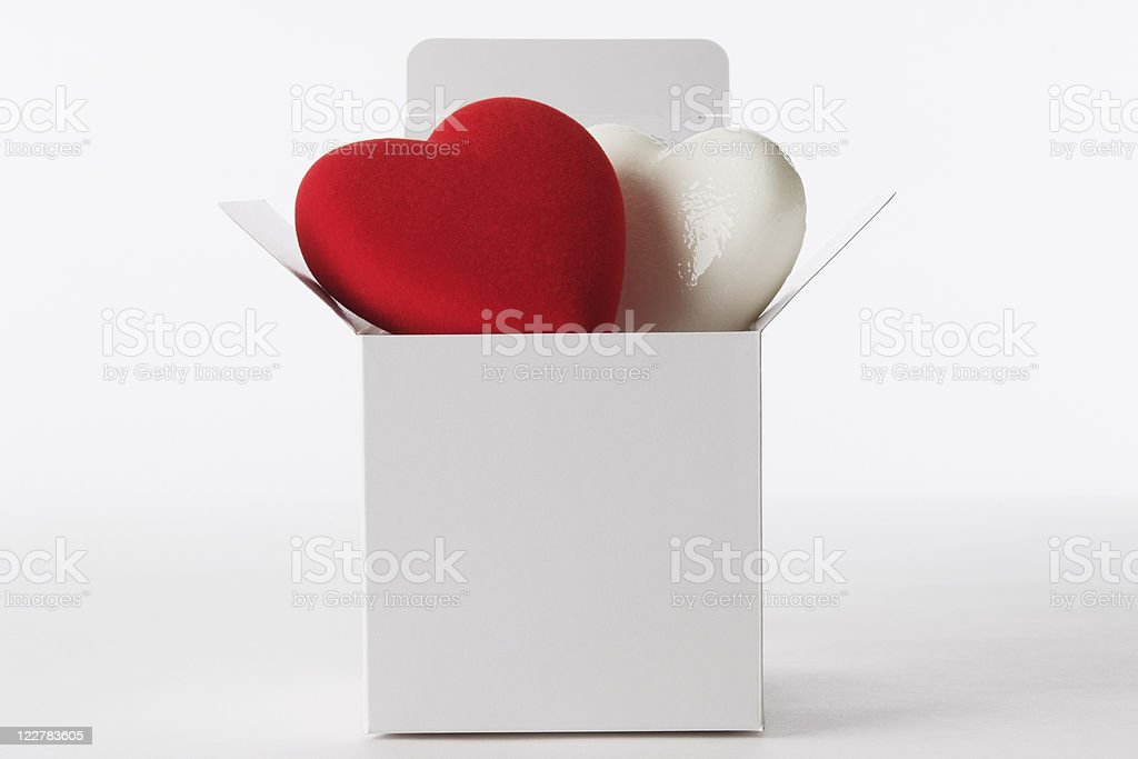 Two heart shape in blank cube box on white background royalty-free stock photo