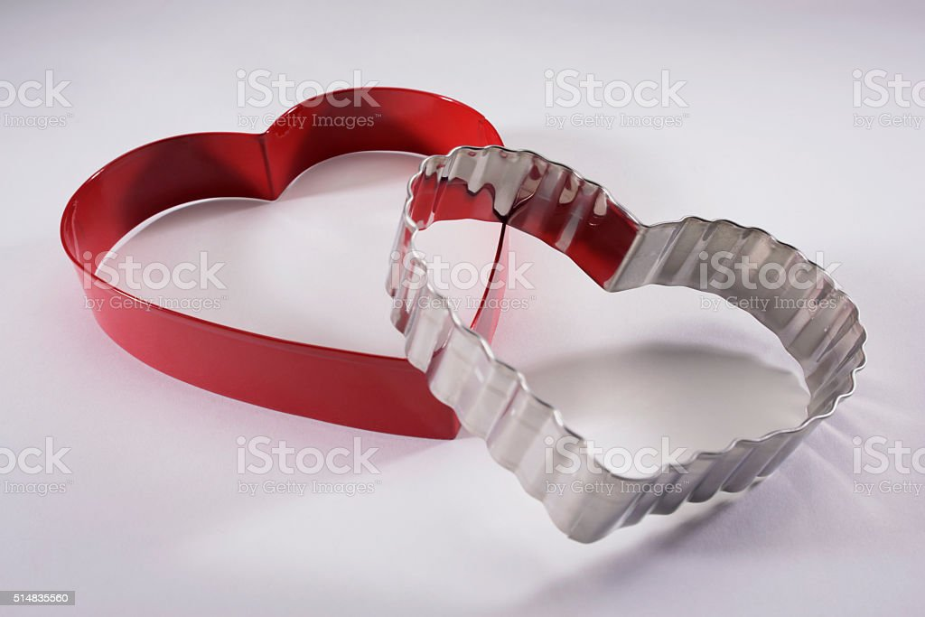Two Heart Shaped Cookie Cutters on a White Background stock photo