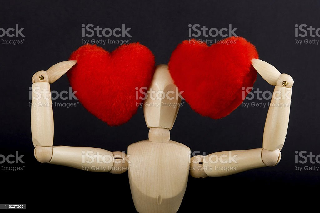Two hearts and a confused men stock photo
