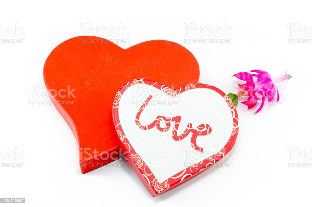 Two hearts and a flower isolated on white royalty-free stock photo