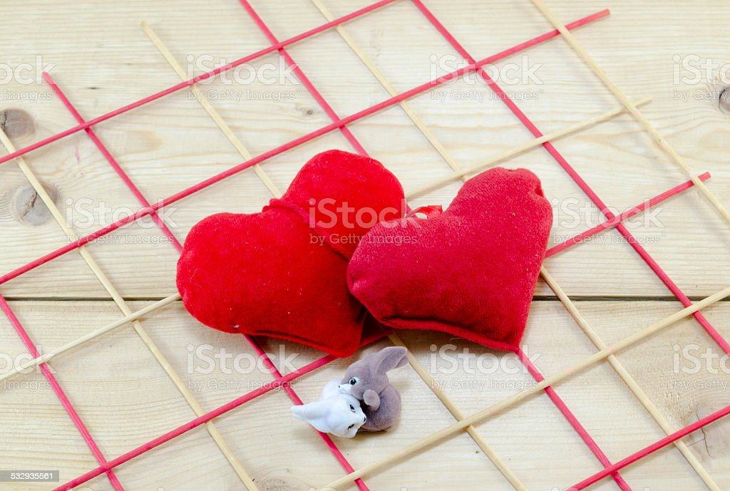 Two hearts and two bunnies hugging royalty-free stock photo