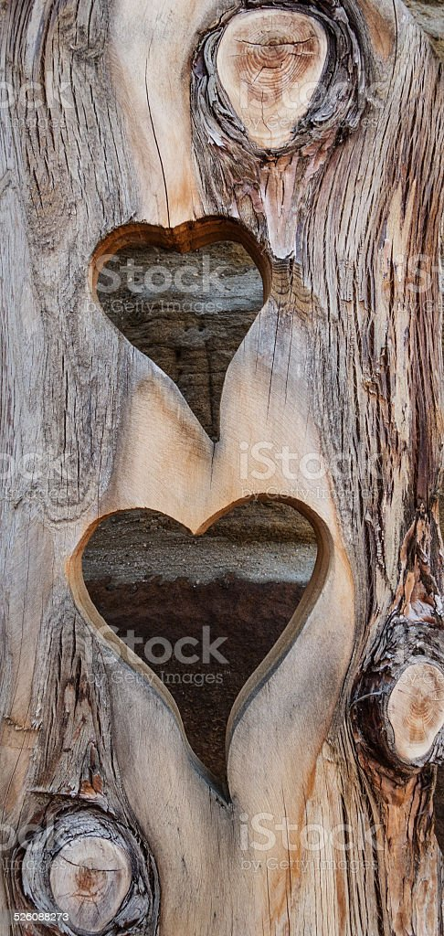 Two hearts cut in wood royalty-free stock photo