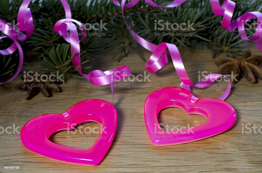 two hearts hanging on the tape stock photo